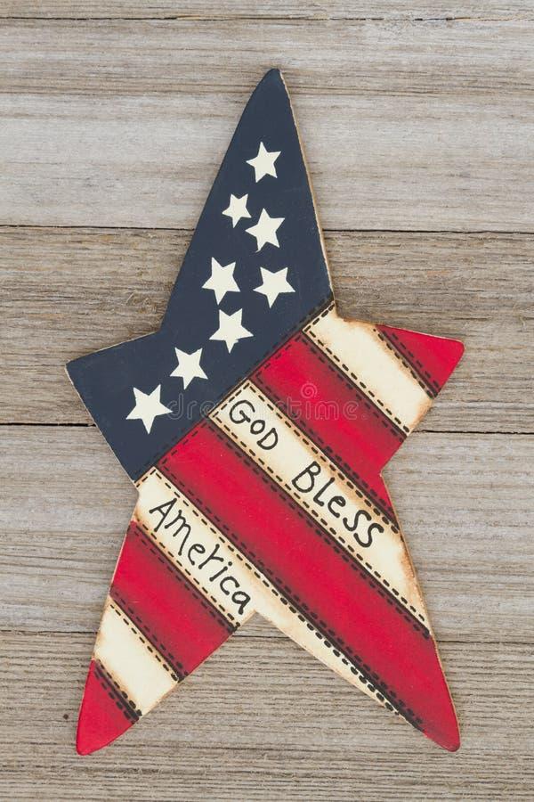 Retro patriotic USA God bless America. Retro patriotic USA message, USA patriotic old star on a weathered wood background stock photo