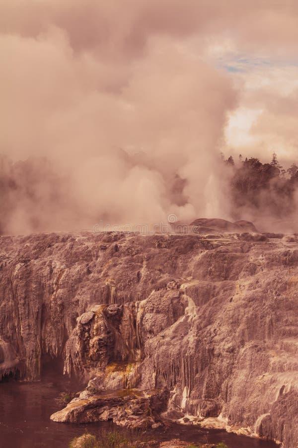 Retro photo of active geysers near Rotorua, New Zealand. Toned image stock photo