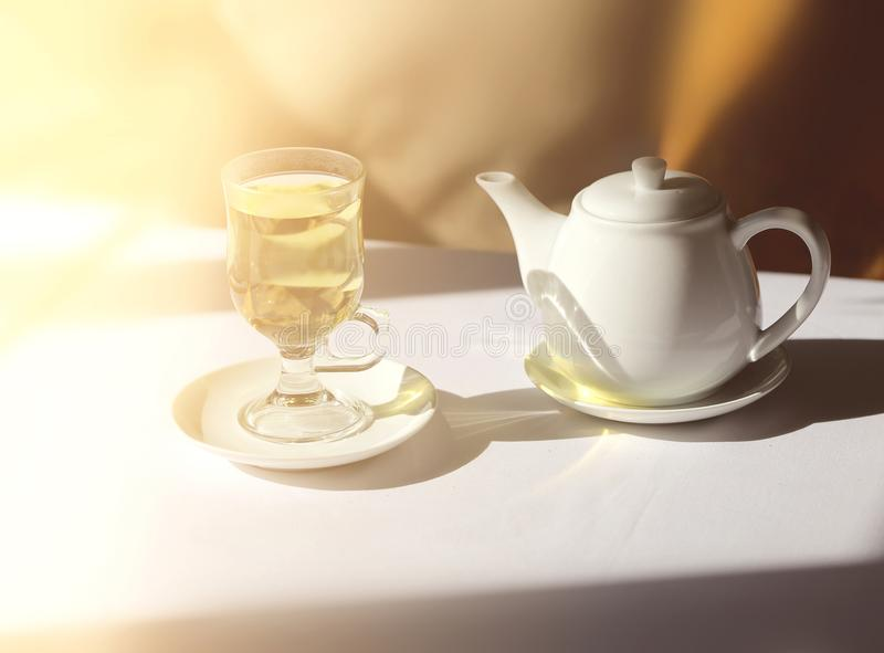 Retro photo of a glass of tea and a kettle stock images
