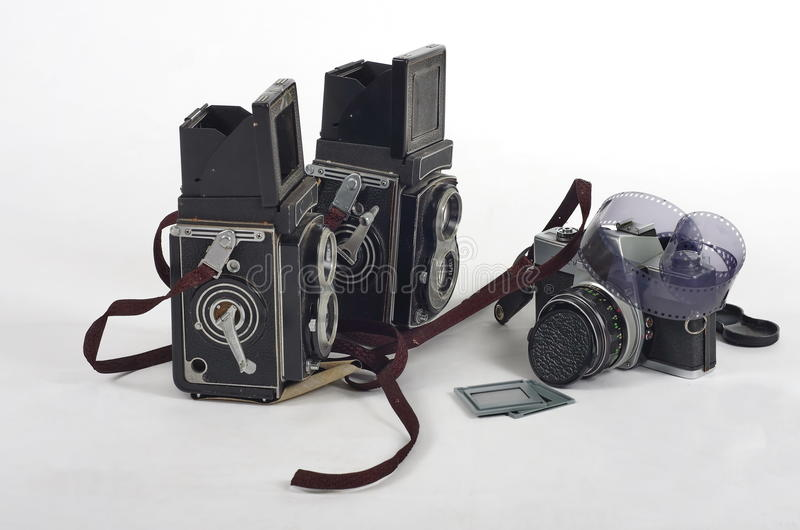 Retro photography cameras. Old retro SLR cameras with film isolated on white background stock photos