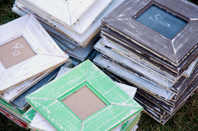 Retro picture frames. A stack of retro designed wooden picture frames on a craft market royalty free stock photos