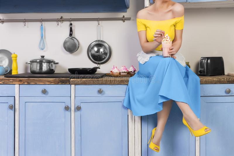 Retro pin up girl housewife in the kitchen stock photography