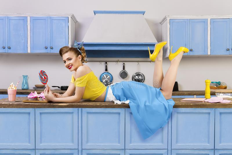Retro pin up girl woman lying relaxing on kitchen stock photos