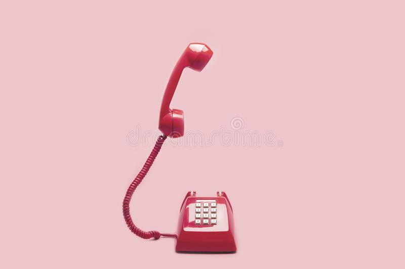 Retro pink telephone royalty free stock images