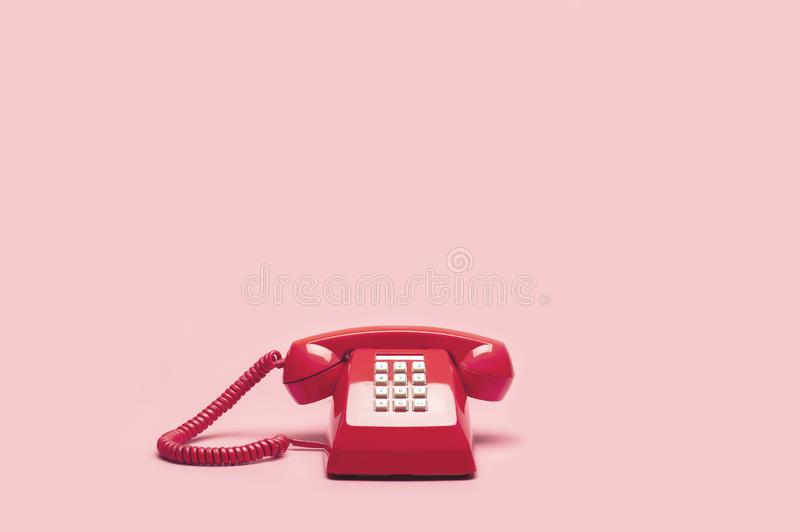 Retro pink telephone royalty free stock photos