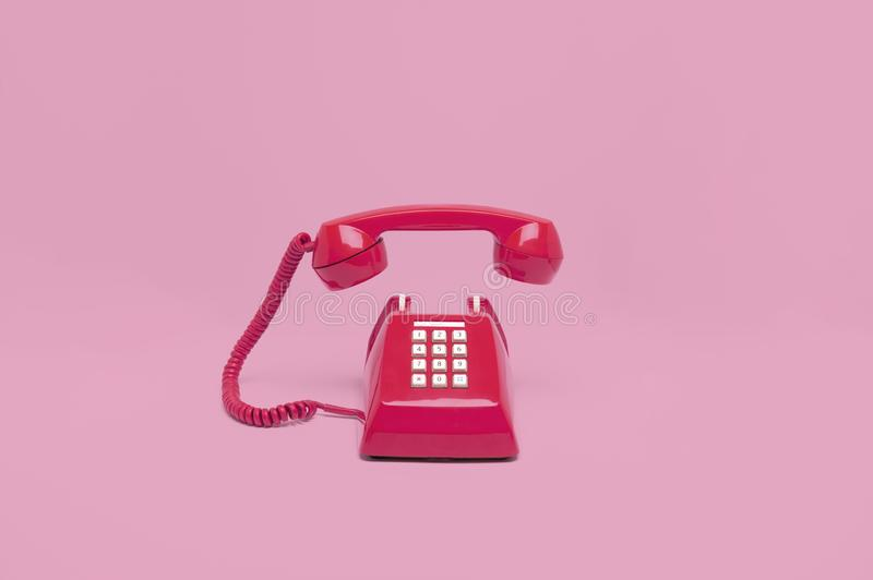 Retro pink telephone stock photos