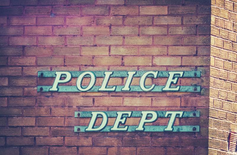 Retro Police Department Sign. Retro Vintage Sign For A Police Department Or Station On A Red Brick Building In Small Town USA royalty free stock photos
