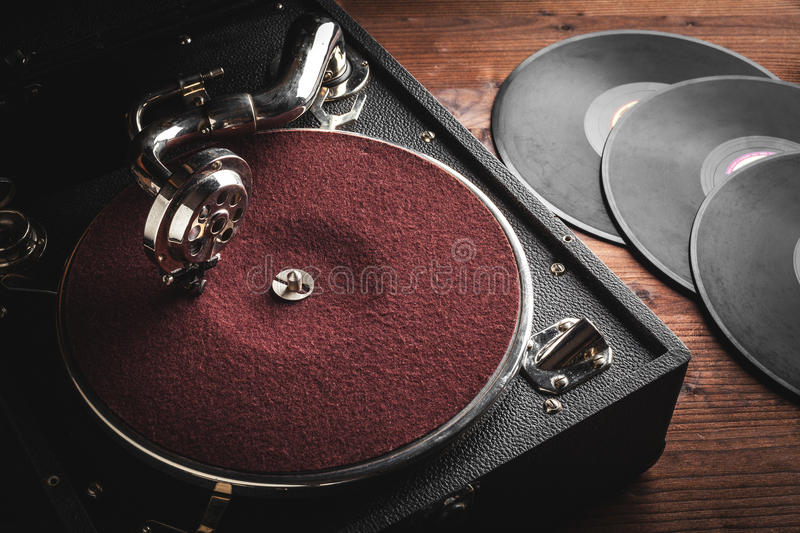 Retro portable turntable. With vynil stock photo