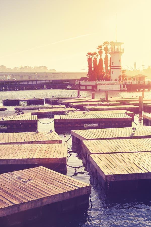 Retro porticciolo tonificato a San Francisco al tramonto immagine stock