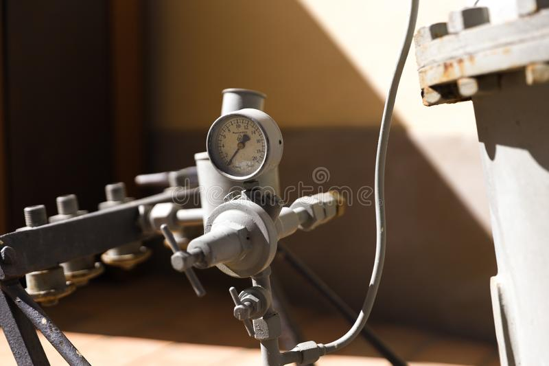 Retro pressure machine from the industrial age. Retro pressure machine from the old industrial revolution age royalty free stock photography