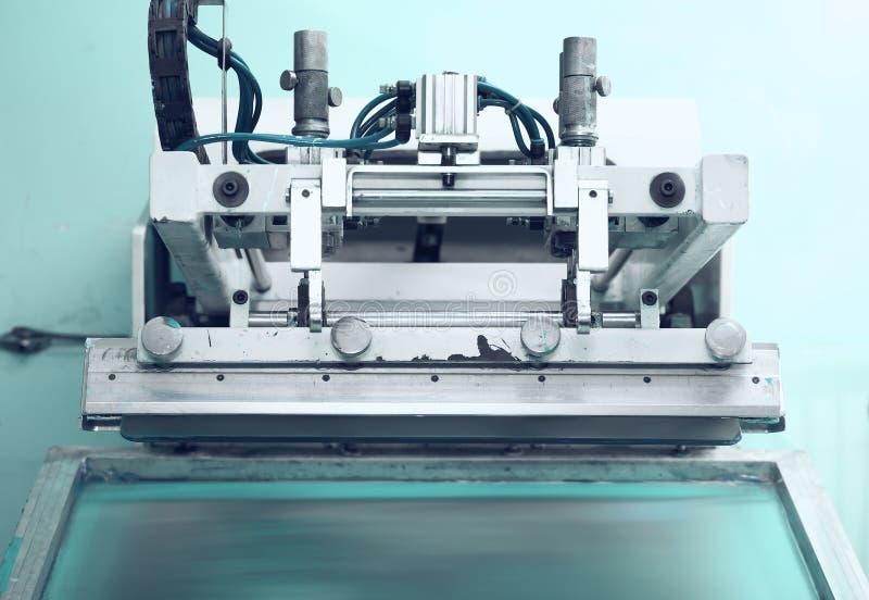 Retro printing press in the silkscreen printing technique stock image