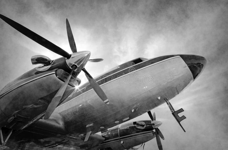 Retro propellervliegtuig stock afbeelding