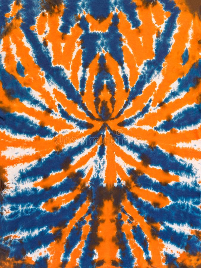 Colorful Abstract Tie Dye Pattern Design Orange Blue Spider. Retro psychedelic colorful abstract tie dye pattern in orange and blue spider design royalty free stock photography