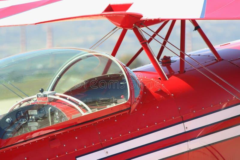 Retro rött flygplan royaltyfria bilder