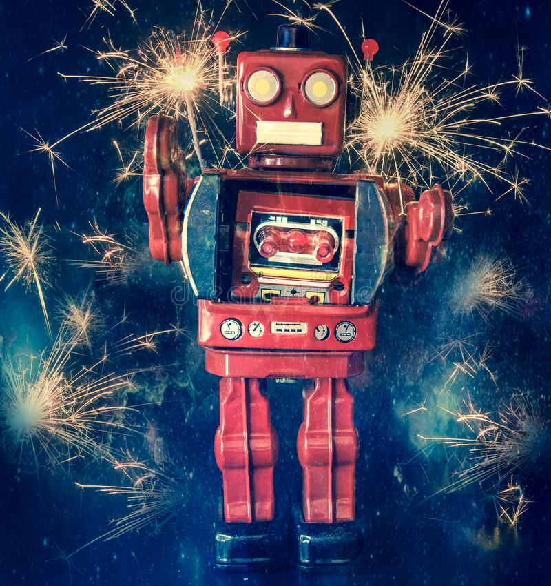 Retro red robot with lots of sparks and fireworks. Retro big red robot with lots of sparks and fireworks royalty free stock photo