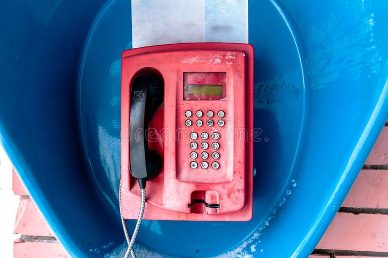 Retro red telephone booth. Retro red telephone in blue booth stock image