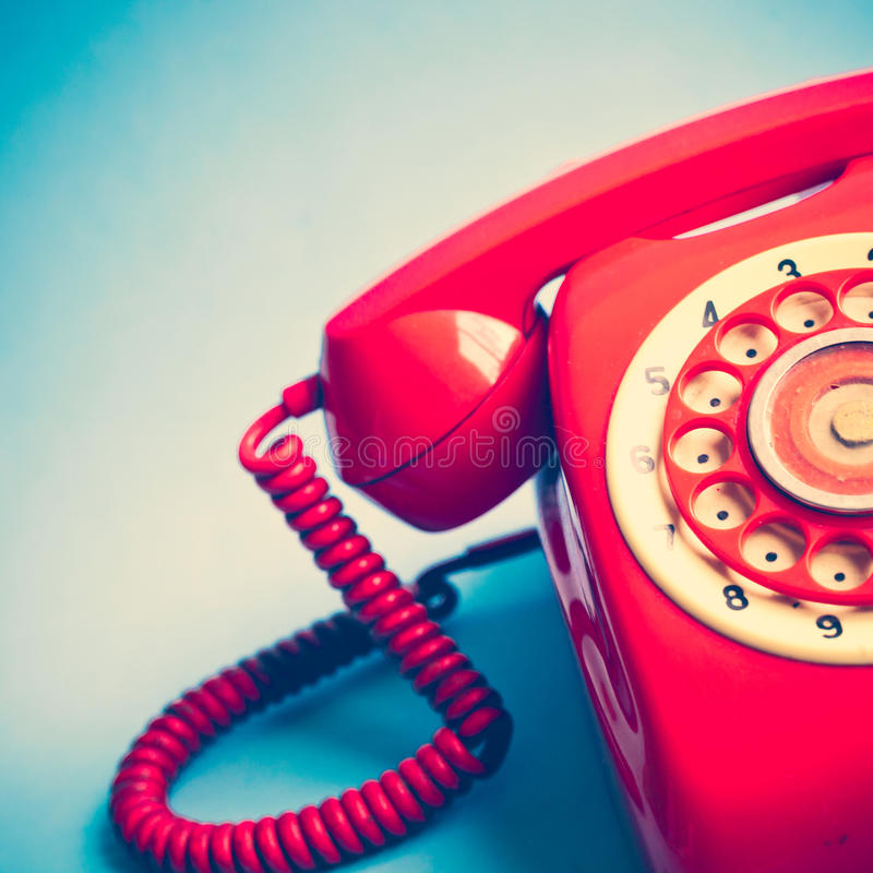 Retro Red Telephone. Over blue background royalty free stock photography