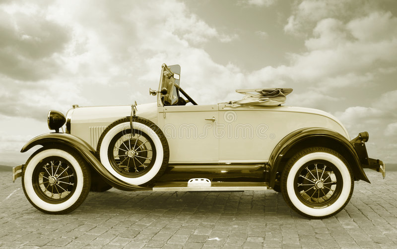 Retro roadster. A vintage car, roadster in toned image royalty free stock photography