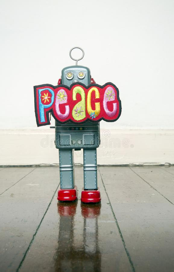 Retro robot podtrzymuje pika znaka obrazy stock