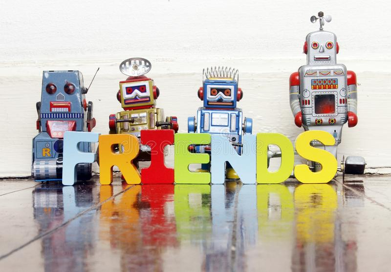 Retro robots and the word FRIENDS royalty free stock image
