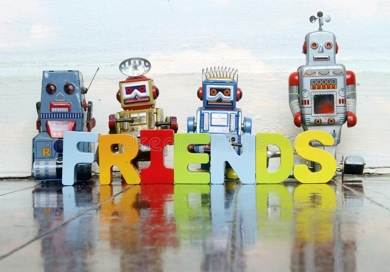 Retro robots and the word FRIENDS royalty free stock images