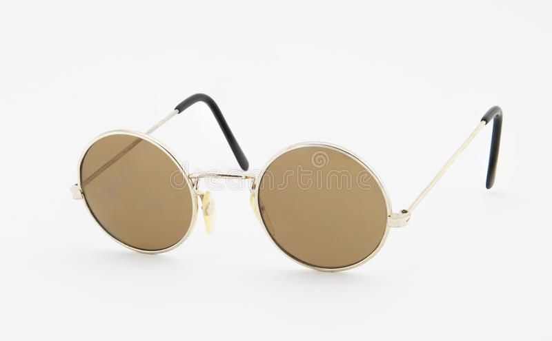 Retro round sunglasses on white background stock photography
