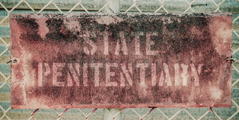 Retro Rusty Prison Sign royalty free stock images
