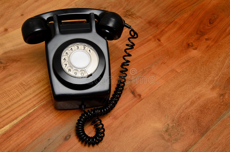 Retro schwarzes Telefon lizenzfreie stockfotografie