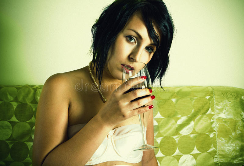 Retro sensual woman with red wine glass royalty free stock photo