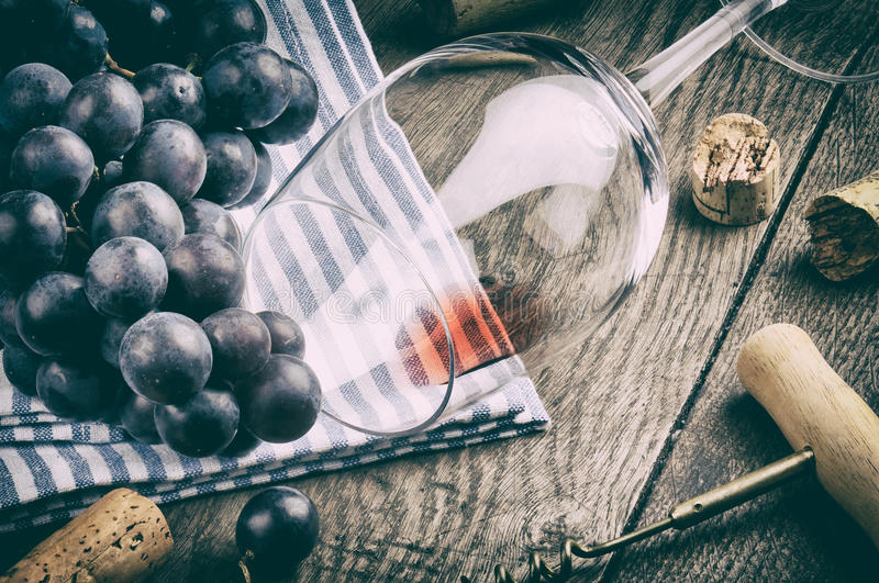 Retro setting with empty wine glass and grapes stock photography