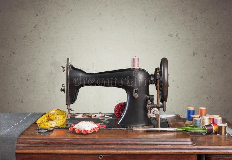 Retro sewing machine with supplies isolated in. Retro machine sew sewing background nobody design royalty free stock photography