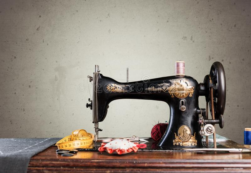 Retro sewing machine with supplies isolated in. Retro machine sew sewing background nobody design royalty free stock photo