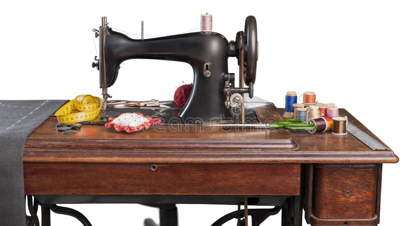 Retro sewing machine with supplies isolated on. Retro machine sew sewing supplies background nobody stock photography