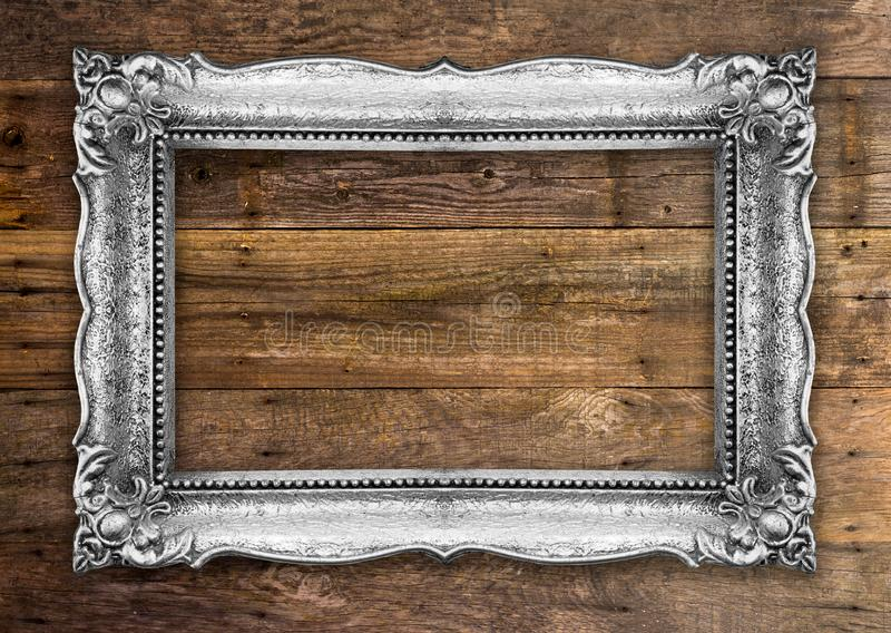 Retro Silver Picture Frame on wooden wall royalty free stock images