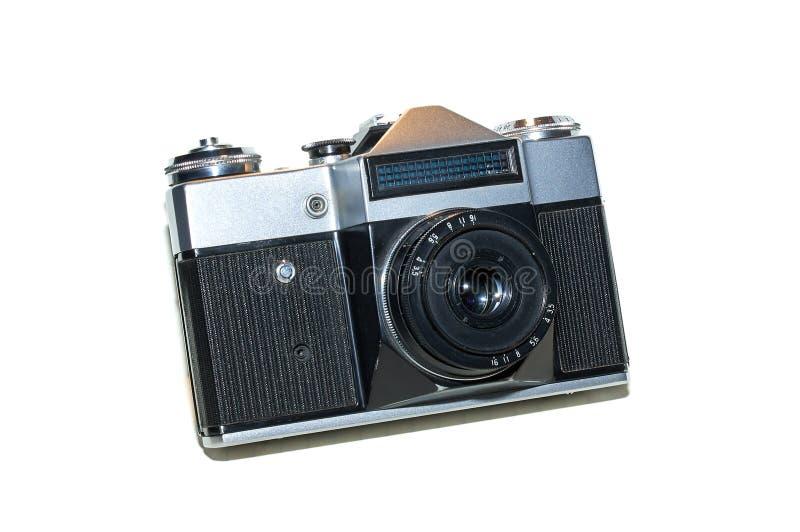Retro slr film photo camera, front angled view on white background. analog vintage film camera.  royalty free stock photo