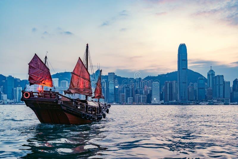 Retro small ship in Hong Kong harbour. Retro small ship in Hong Kong harbour at sunset time stock photos
