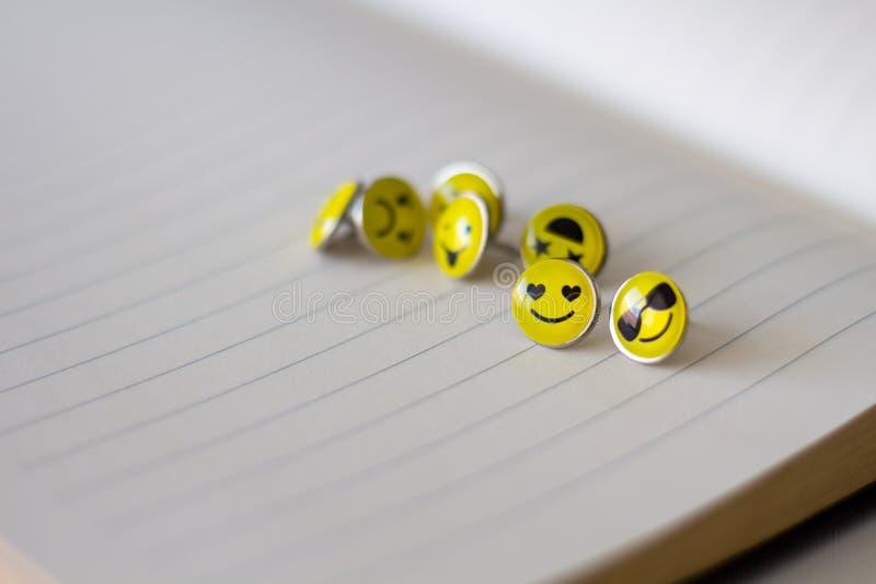 Retro Smiley Face Emoticon Push Pins. And stacionary royalty free stock image