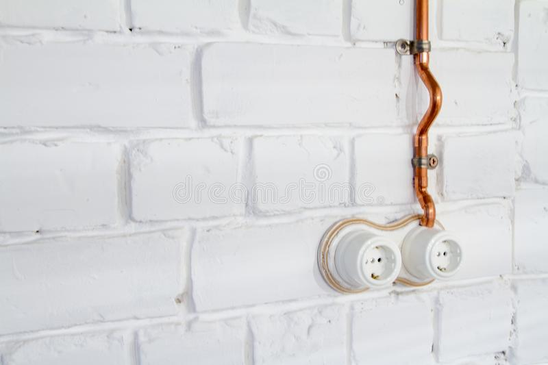 A Vintage Outlet And Electrical Wiring In A Copper Tube ... on