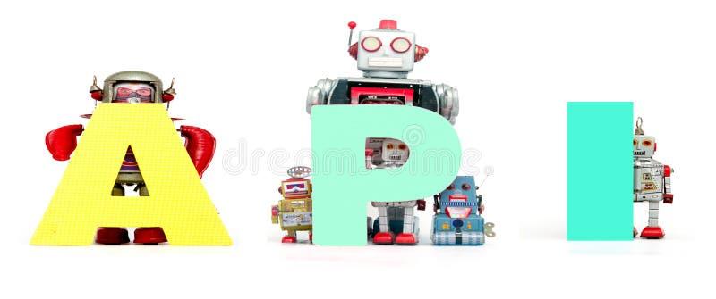 Retro speelgoed van de tinrobot steunt het geïsoleerde acroniem API royalty-vrije stock foto's