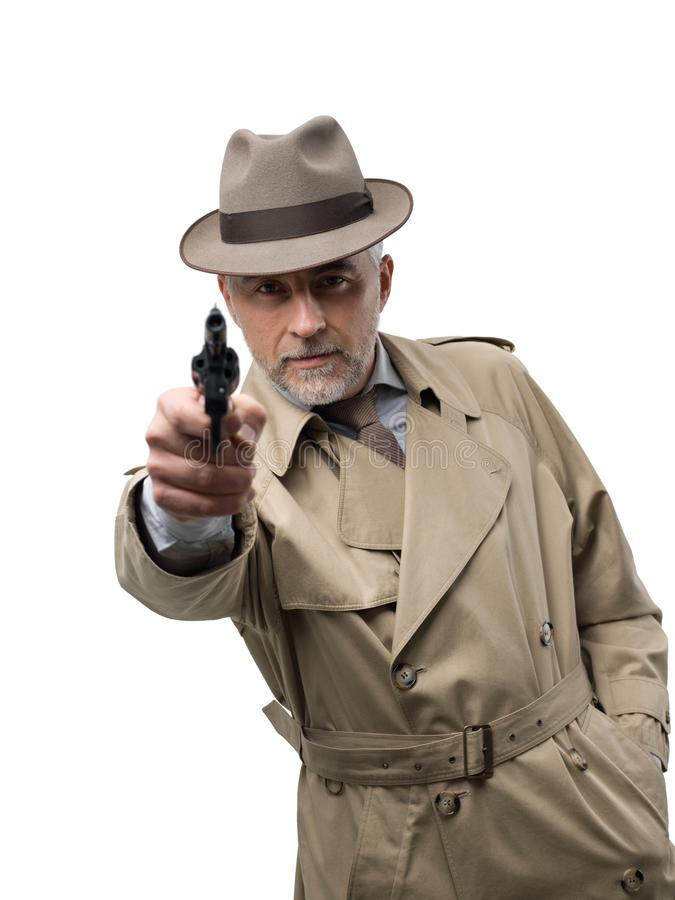 Retro spy agent with revolver stock photos