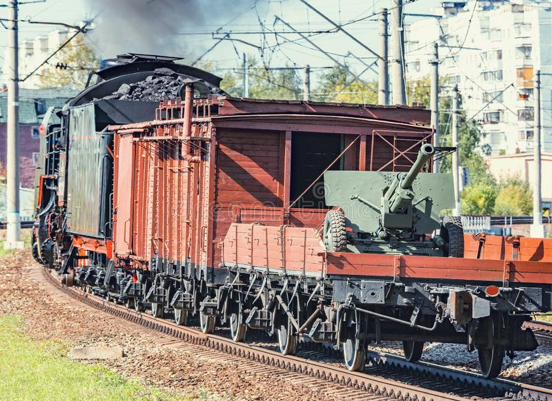 Retro steam freight train departs from the railway station with military cargo. Moscow. Russia royalty free stock photos