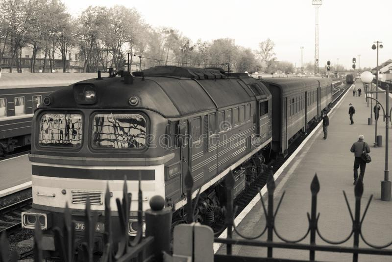 Retro steam train departs from the station.  stock photos