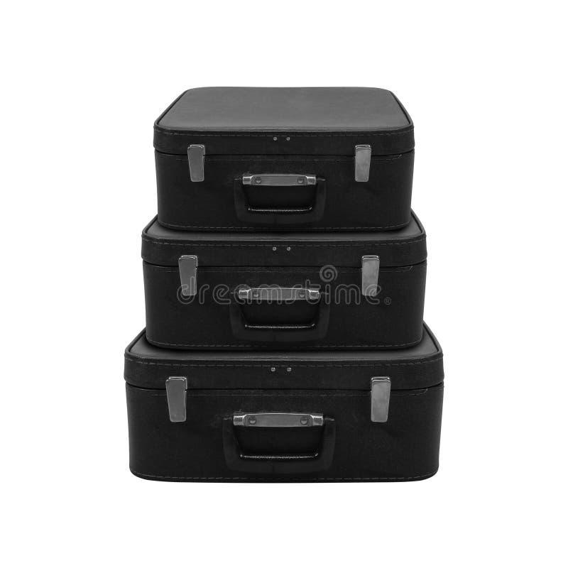 Retro stil - svart resväska för tappning tre isolerat royaltyfri bild