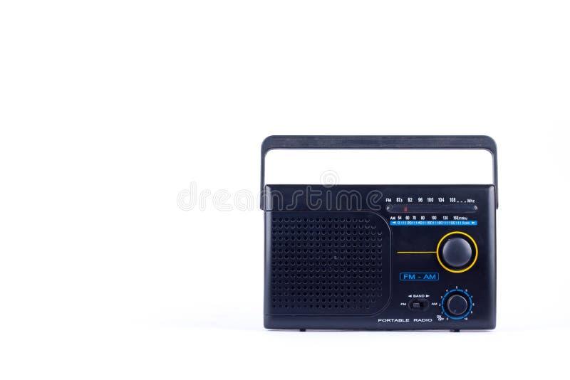 Retro stile d'annata nero, ricevitore del transistor della radio portatile di FM su fondo bianco isolato fotografia stock