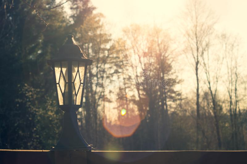 Retro street lamp at sunset. Vintage lantern at evening light. Background, antique, architecture, city, old, sky, town, art, beautiful, bulb, design, dusk royalty free stock photo