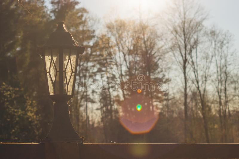 Retro street lamp at sunset. Vintage lantern at evening light. Background, antique, architecture, city, old, sky, town, art, beautiful, bulb, design, dusk stock photography