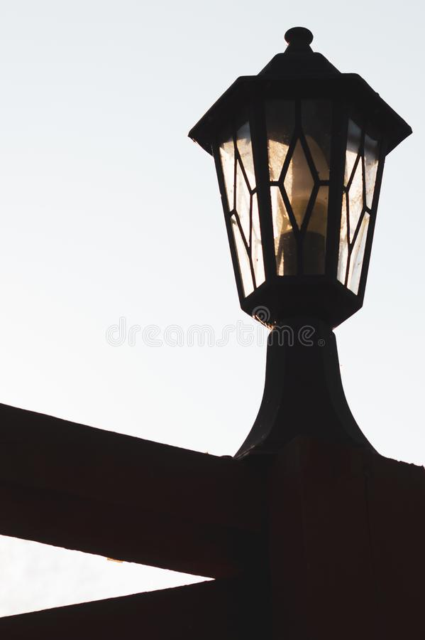 Retro street lamp at sunset. Vintage lantern at evening light. Retro street lamp at sunset. Vintage lantern silhouette. copy space, antique, architecture, city stock images
