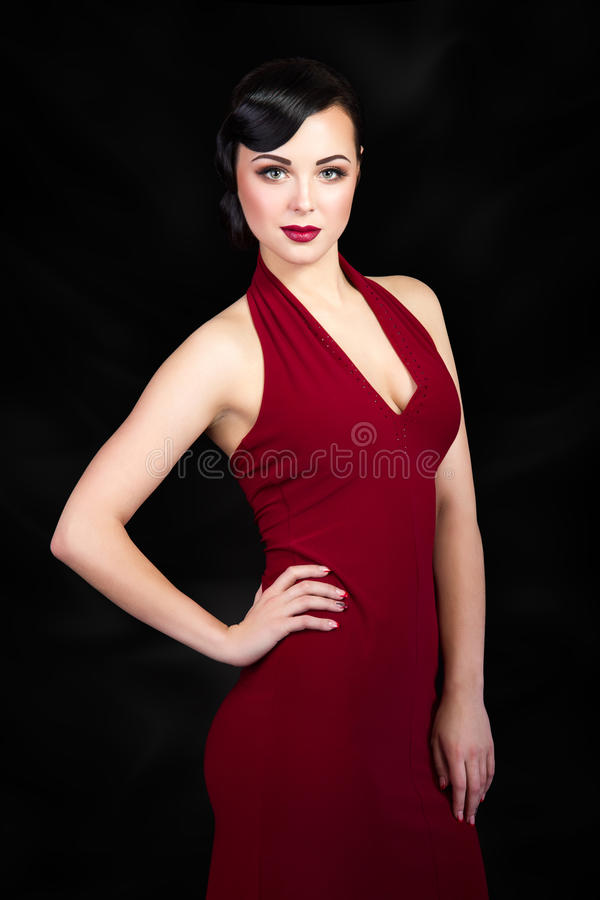 Retro style brunette woman with hand on her waist royalty free stock photos