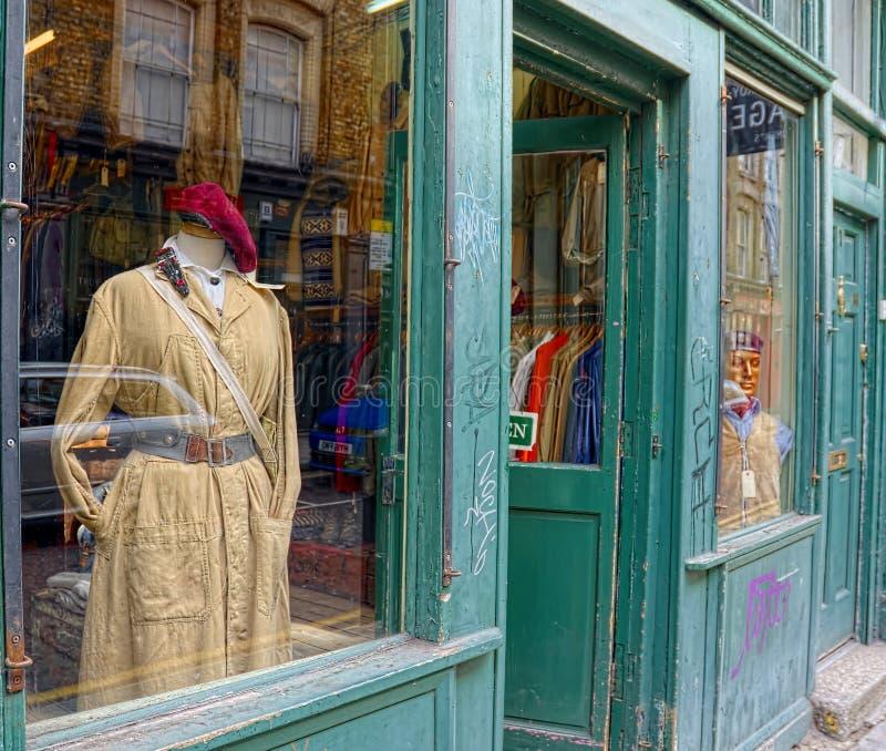 Retro style chic fashion raincoat and beret stock images