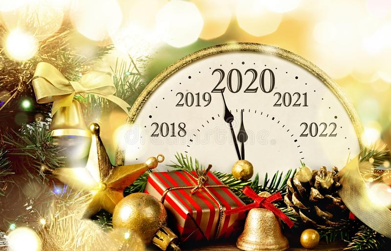 Retro style clock New Year`s Eve 2020 with christmas and new year decorations. New Year`s Eve. Retro style clock with christmas decorations. Happy new year 2020 stock photography